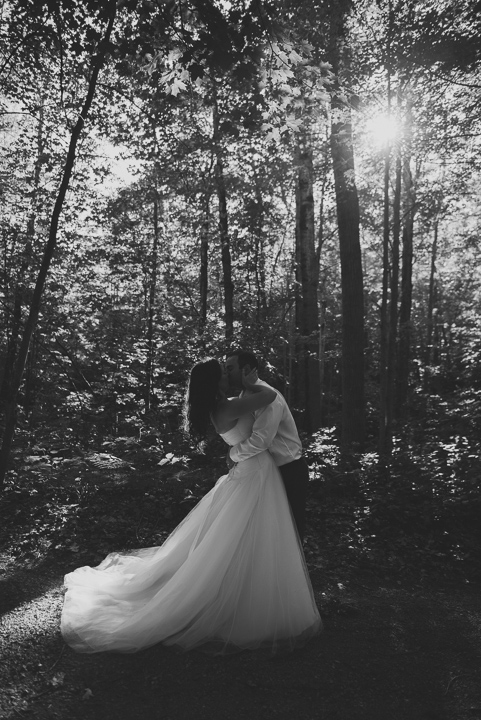 bride groom in forest kissing